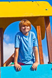 Happy teenager at a playground. Portrait of happy teenager at a playground Stock Photo