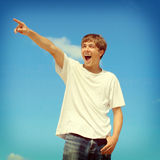 Happy Teenager pointing Royalty Free Stock Photos