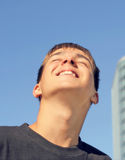 Happy Teenager. Portrait on the Blue Sky Background Royalty Free Stock Photography