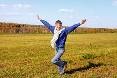Happy teenager running Stock Photo