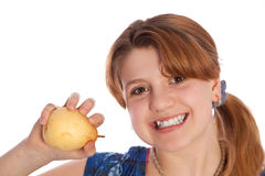 Happy Teenager showing a pear Stock Image