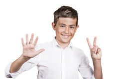 Happy teenager showing seven fingers, number 7 gesture Stock Photography