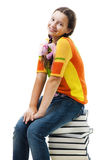 Happy teenager sit on stack of books royalty free stock photography