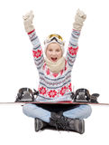 Happy teenager sitting arms in the air, to the winter sports Stock Image
