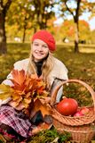 Happy teenager smiling. Autumn portrait of beautiful young girl in red hat royalty free stock photos