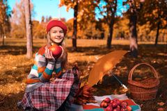 Happy teenager smiling. Autumn portrait of beautiful young girl in red hat stock photo