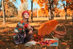 Happy teenager smiling. Autumn portrait of beautiful young girl in red hat royalty free stock photo