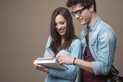 Happy teenager students Stock Photos