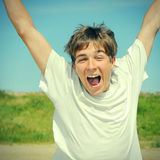 Happy Teenager. Toned photo of Happy Teenager running at the Summer Day outdoor Stock Photo