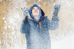 Happy teenager trowing snow Stock Photos