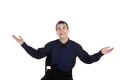Happy teenager on white background looking up Stock Photography