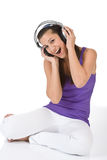 Happy teenager woman enjoy music with headphones Stock Image