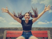 Happy teenager woman outside gesturing hands royalty free stock photo