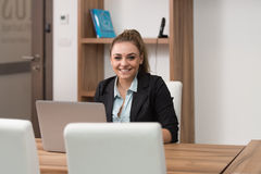 Happy Teenager Working On Laptop In Library Royalty Free Stock Image