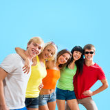 Happy teenagers on a blue background Stock Photo