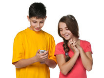 Happy teenagers with a cell phone royalty free stock photography