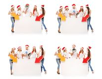 Happy teenagers in Christmas hats with white banners Royalty Free Stock Photo