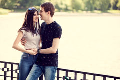 Happy teenagers couple in a walk in the park. Outdoor photo. Happy relationship Royalty Free Stock Image