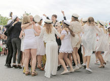 Happy teenagers dancing at the graduation stock photography