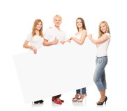 Happy teenagers holding a blank white banner Stock Image