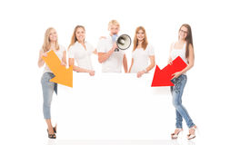Happy teenagers holding pointers and a banner. Group of teenagers with a blank, white billboard isolated on white Royalty Free Stock Images