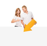 Happy teenagers holding pointers and a banner Stock Photo