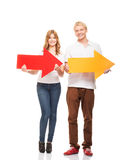 Happy teenagers holding pointers and a banner Royalty Free Stock Photography