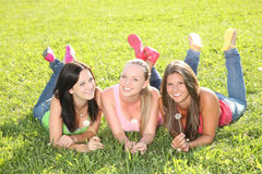 Happy teenagers lying in the grass Royalty Free Stock Photography