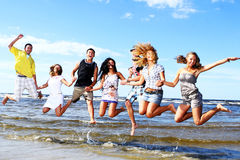 Happy teenagers playing at the sea Royalty Free Stock Images