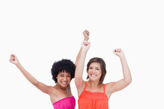 Happy teenagers raising their arms Stock Photo