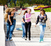 Happy teenagers running Stock Image
