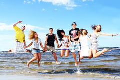 Happy teenagers at the sea Stock Images