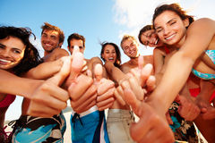 Happy teenagers showing a thumbs up sign Stock Photo