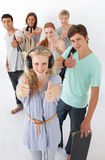 Happy teenagers smiling at the camera Stock Photo