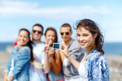 Happy teenagers taking photo outside Stock Photography