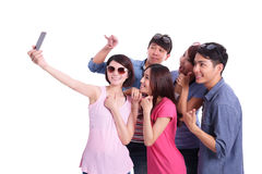 Happy teenagers taking pictures Stock Photography