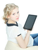 Happy teenege girl with tablet pc computer Stock Images