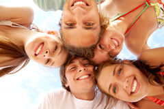 Happy teens. Below view of joyful teens looking at camera with smiles on vacation Royalty Free Stock Photos
