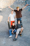 Happy teens. Group of happy teen skaterboard boys playing outdoors Royalty Free Stock Photo