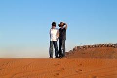 Happy Teens in a Desert Stock Image