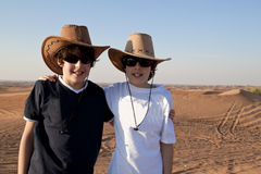Happy Teens in a Desert. Happy Teens in a   Arabian Desert ,Dubai Royalty Free Stock Photos