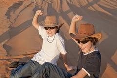 Happy Teens in a Desert. Happy Teens in a   Arabian Desert ,Dubai Royalty Free Stock Image