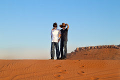 Happy Teens in a Desert. Happy Teens in a   Arabian Desert ,Dubai Royalty Free Stock Images