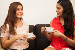 Happy teens drinking coffee Royalty Free Stock Photography