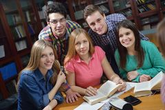 Happy teens group in school Stock Images