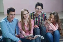 Happy teens group in school Stock Image