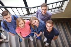 Happy teens group in school Royalty Free Stock Photo