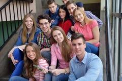 Happy teens group in school stock photography
