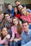 Happy teens group in school Royalty Free Stock Images