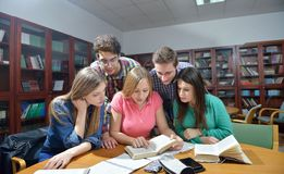 Happy teens group in school Stock Photography